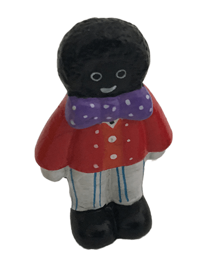 Miniature male golly standing in red jacket