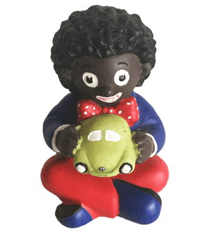 Miniature Golliwog Boy sitting with car