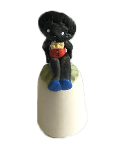 Golliwog Sitting on Thimble