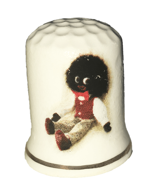 Thimble with sitting golliwog